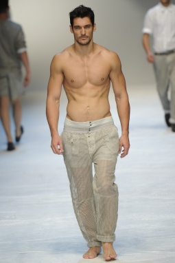 Model David Gandy displays a creation as